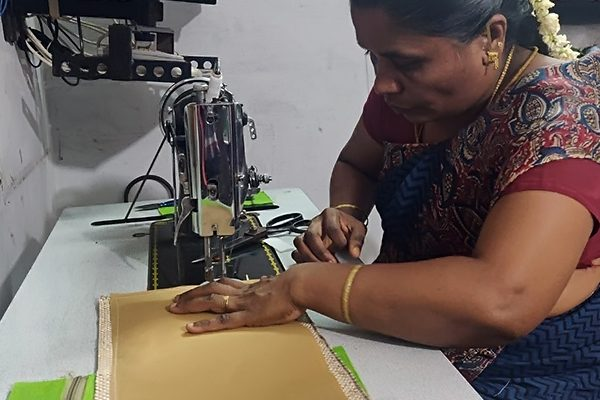women stitching bag