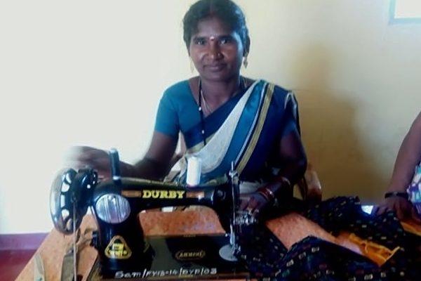 women tailoring cloth
