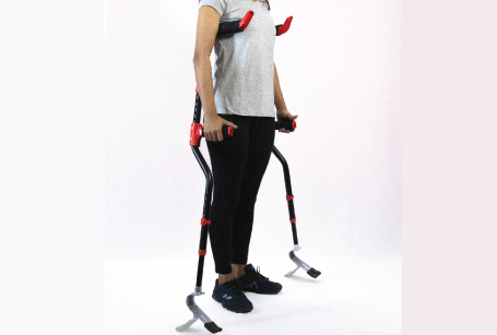 girl standing with flexmo crutches